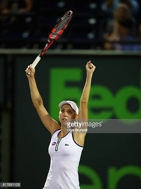 Elena Vesnina of Russia celebrates match point against Venus Williams of the United States in the second round match during the Miami Open Presented...