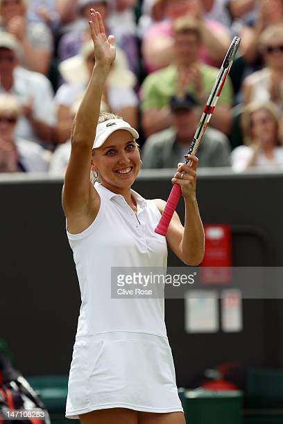 Elena Vesnina of Russia celebrates match point during her ladies' singles first round match against Venus Williams of USA on day one of the Wimbledon...