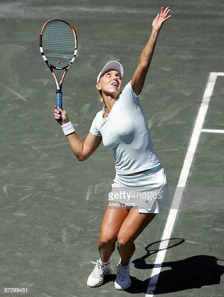 Elena Vesnina of Russia hits a serve during her first round match against Vera Zvonareva of Russia on April 10 2006 at the Family Circle Tennis...