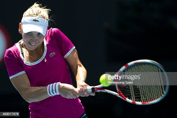 Elena Vesnina of Russia in action during her fourth round match against Victoria Azarenka of Belarus during day eight of the 2013 Australian Open at...