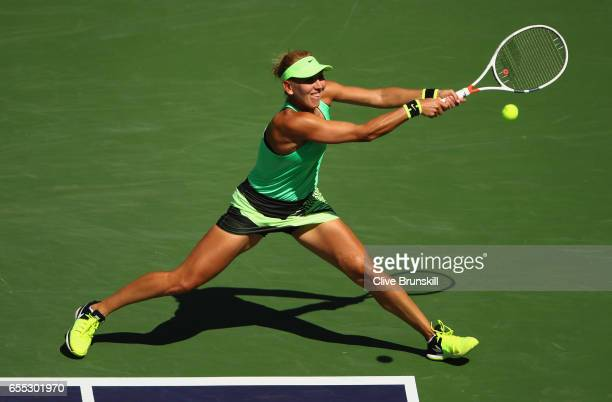 Elena Vesnina of Russia plays a backhand against Svetlana Kuznetsova of Russia in the womens final during day fourteen of the BNP Paribas Open at...