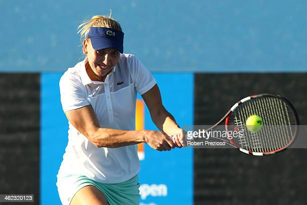 Elena Vesnina of Russia plays a backhand in her first round match against Alison Riske of the United States during day one of the 2014 Australian...