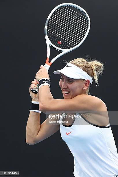 Elena Vesnina of Russia plays a backhand in her first round match against Ana Bogdan of Romania on day two of the 2017 Australian Open at Melbourne...