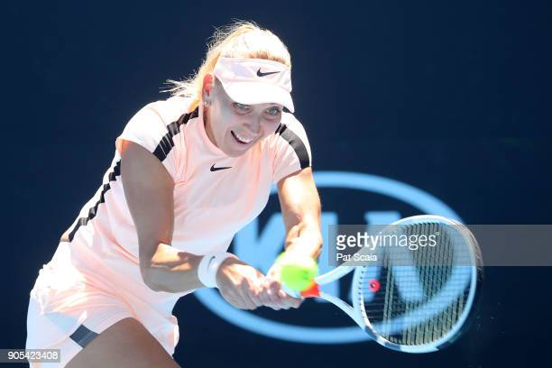 Elena Vesnina of Russia plays a backhand in her first round match against Ons Jabeur of Tunisia on day two of the 2018 Australian Open at Melbourne...