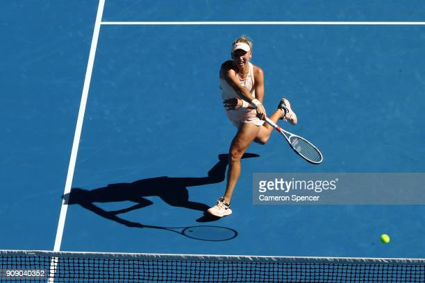 Elena Vesnina of Russia plays a backhand in her women's doubles match with Ekaterina Makarova of Russia against Yifan Xu of China and Gabriela...