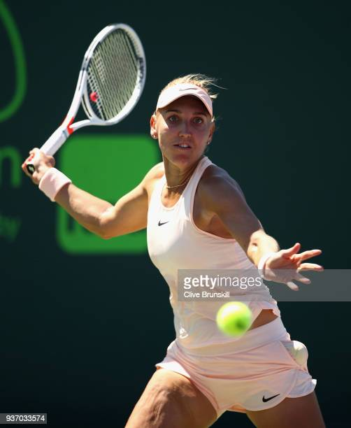 Elena Vesnina of Russia plays a forehand against Donna Vekic of Croatia in their second round match during the Miami Open Presented by Itau at...