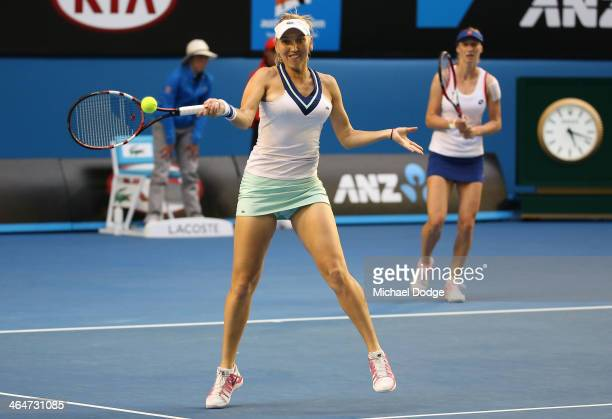 Elena Vesnina of Russia plays a forehand in her doubles final match with Ekaterina Makarova of Russia against Sara Errani of Italy and Roberta Vinci...
