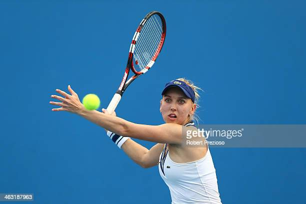 Elena Vesnina of Russia plays a forehand in her first round doubles match with Ekaterina Makarova of Russia against Lauren Davis of the United States...