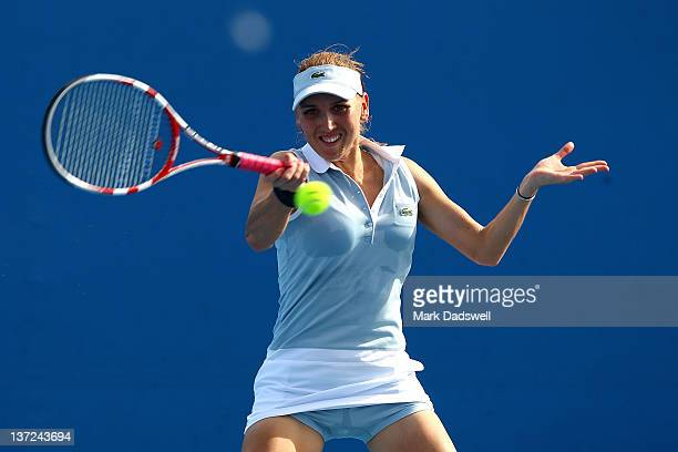 Elena Vesnina of Russia plays a forehand in her first round match against Stephanie Dubois of Canada during day two of the 2012 Australian Open at...