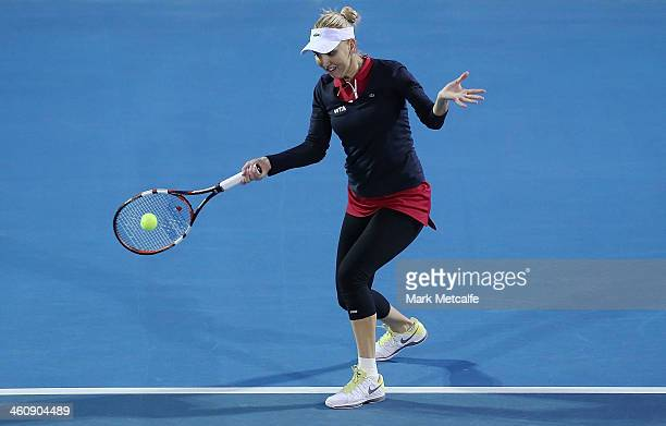 Elena Vesnina of Russia plays a forehand in her first round match against Monica Puig of Puerto Rico during day two of the Moorilla Hobart...
