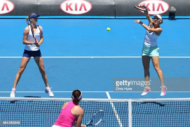 Elena Vesnina of Russia plays a forehand in her quarterfinal doubles match with Ekaterina Makarova of Russia against Raquel KopsJones of the United...