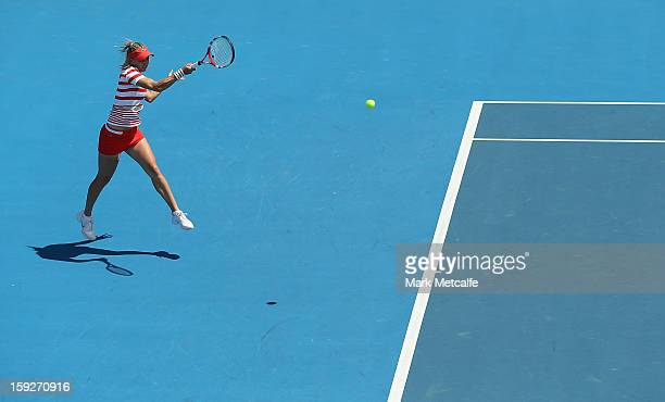 Elena Vesnina of Russia plays a forehand in her semi final match against Sloane Stephens of the USA during day eight of the Hobart International at...