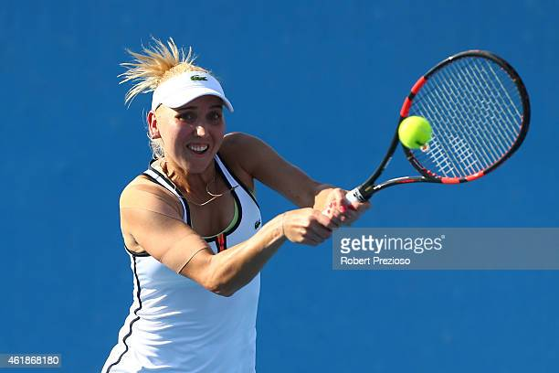 Elena Vesnina of Russia plays a forehand in their first round doubles match with Ekaterina Makarova of Russia against Madison Keys of the United...