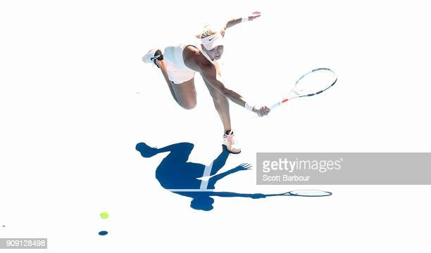 Elena Vesnina of Russia plays a shot with her parther Ekaterina Makarova of Russia in their women's doubles match against Yifan Xu of China and...
