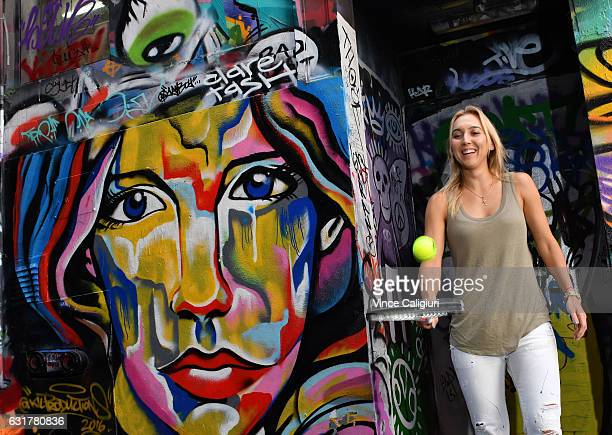 Elena Vesnina of Russia poses at the famous graffiti laneway Hosier Lane in Melbourne during day 1 of the 2017 Australian Open at Melbourne Park on...