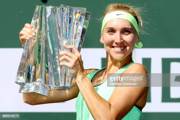 Elena Vesnina of Russia poses for photographers with the winner's trophy after defeating Svetlana Kuznetsova of Russia during the women's final of...
