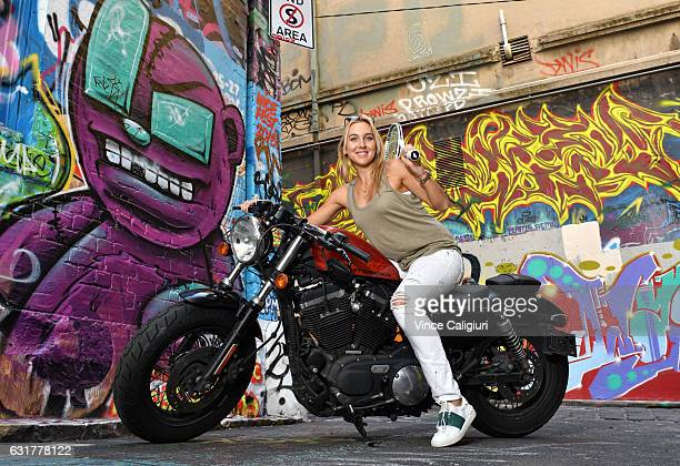 Elena Vesnina of Russia poses on a Harley Davidson at the famous graffiti laneway Hosier Lane in Melbourne during day 1 of the 2017 Australian Open...