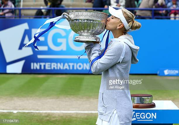 Elena Vesnina of Russia poses with the trophy after defeating Jamie Hampton of the USA in the women's singles final match during the day eight of the...