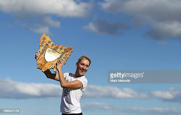 Elena Vesnina of Russia poses with the winners trophy on a visit to Battery Point after victory in the Women's singles final match against Mona...