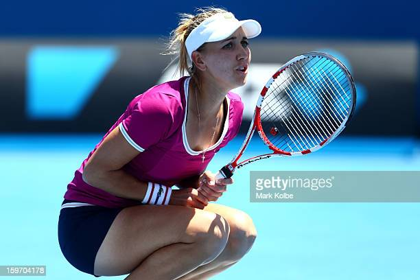 Elena Vesnina of Russia reacts to a point in her third round match against Roberta Vinci of Italy during day six of the 2013 Australian Open at...