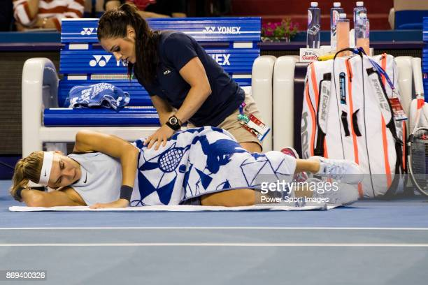 Elena Vesnina of Russia receives medical treatment during the singles Round Robin match of the WTA Elite Trophy Zhuhai 2017 against Coco Vandeweghe...