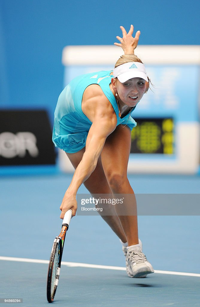 Elena Vesnina of Russia recovers after returning a ball to M : ニュース写真