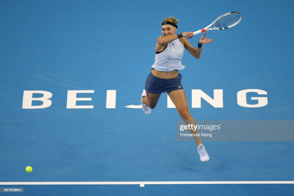 Elena Vesnina of Russia returns a shot against Elina Svitolina of Ukraine during the Women's singles third round match on day six of the 2017 China Open at the China National Tennis Centre on October 5, 2017 in Beijing, China.
