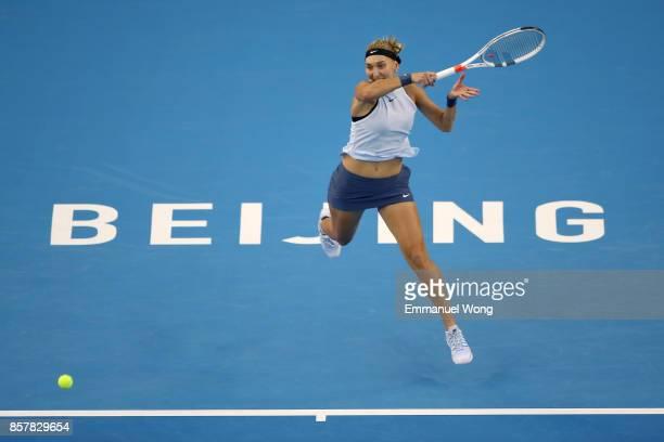 Elena Vesnina of Russia returns a shot against Elina Svitolina of Ukraine during the Women's singles thrid round match on day six of the 2017 China...