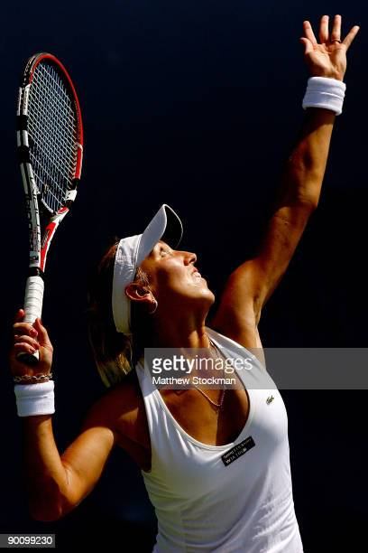 Elena Vesnina of Russia serves to Samatha Stosur ofAustralia during the Pilot Pen Tennis tournament at the Connecticut Tennis Center at Yale on...