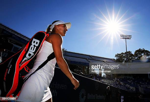 Elena Vesnina of Russia walks on the court before her match against Annett Kontaveit of Estonia on day 3 of the Connecticut Open at the Connecticut...