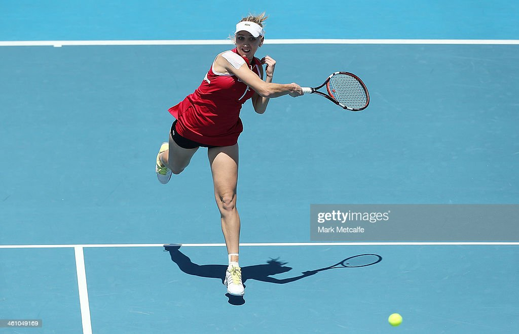 Elena Visnina of Russia hits a forehand in her first round match against Monica Puig of Puerto Rica during day three of the Moorilla Hobart International at Domain Tennis Centre on January 7, 2014 in Hobart, Australia.
