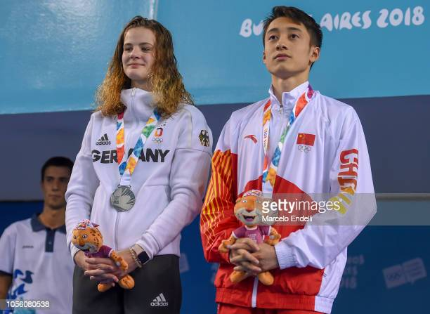 Elena Wassen of Germany and Junjie Lian of China pose with their Silver Medals after the Mixed International Team Final during Day 11 of Buenos Aires...