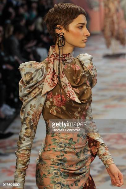 Elena Zinchenko walks the runway wearing Zimmermann Fall 2018 with makeup by Jodie Boland and hair by Renya Xydis at Gallery I at Spring Studios on...