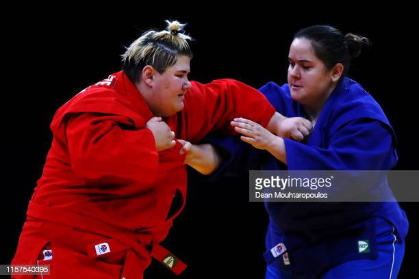 Elene Kebadze of Georgia competes against Elena Chirac of France during Women's 80kg Sambo Semi Final match during the 2nd European Games held in the...