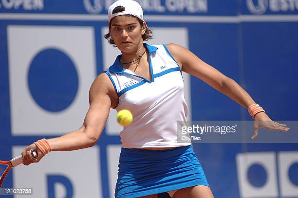 Eleni Danilidou in action against Flavia Pennetta during their quarterfinal match in the 2006 Estoril Open at the Estadio Nacional in Estoril...