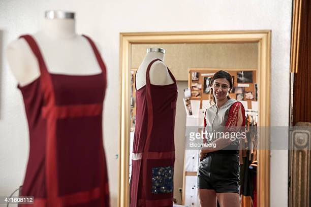 Eleni Kyriacou a fashion designer poses for a photograph in her studio in Athens Greece on Saturday April 25 2015 The downturn that decimated the...