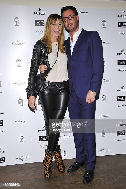 Elenoire Casalegno and Lorenzo Tonetti attend 'The Faces' Opening Exhibition on February 17 2014 in Milan Italy