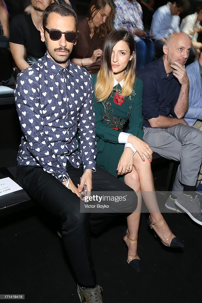 Eleonora Carisi and guest attend the John Richmond show during Milan Menswear Fashion Week Spring Summer 2014 show on June 24, 2013 in Milan, Italy.