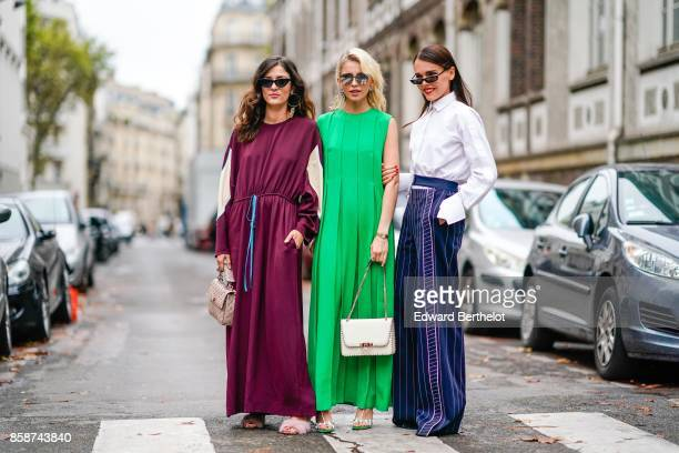 Eleonora Carisi Caroline Daur and Evangelie Smyrniotaki outside Valentino during Paris Fashion Week Womenswear Spring/Summer 2018 on October 1 2017...