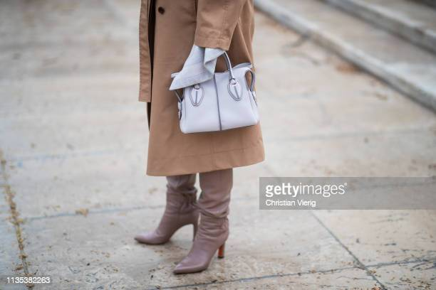 Eleonora Carisi is seen wearing bag brown belted trench coat boots outside Tods lunch during Paris Fashion Week Womenswear Fall/Winter 2019/2020 on...
