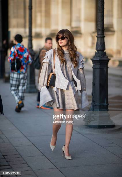 Eleonora Carisi is seen wearing dress with long sleeves vest outside Louis Vuitton during Paris Fashion Week Womenswear Fall/Winter 2019/2020 on...