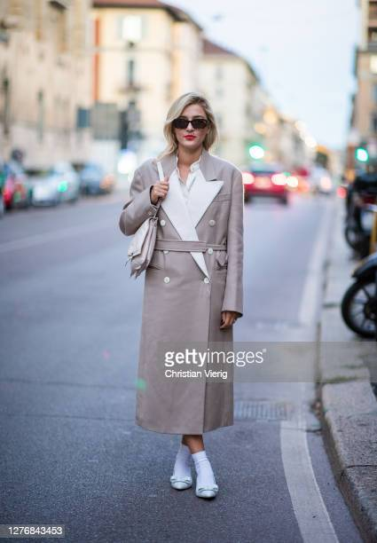 Eleonora Carisi seen wearing coat outside Ferragamo during the Milan Women's Fashion Week on September 26, 2020 in Milan, Italy.