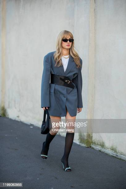 Eleonora Carisi seen wearing grey blazer dress knee socks Prada bag heels outside Prada during Milan Fashion Week Fall/Winter 2020/2021 on January 12...