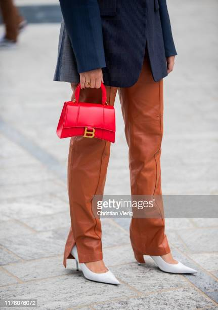 Eleonora Carisi seen wearing rusty brown leather pants navy blazer red mini bag outside the Sportmax show during Milan Fashion Week Spring/Summer...