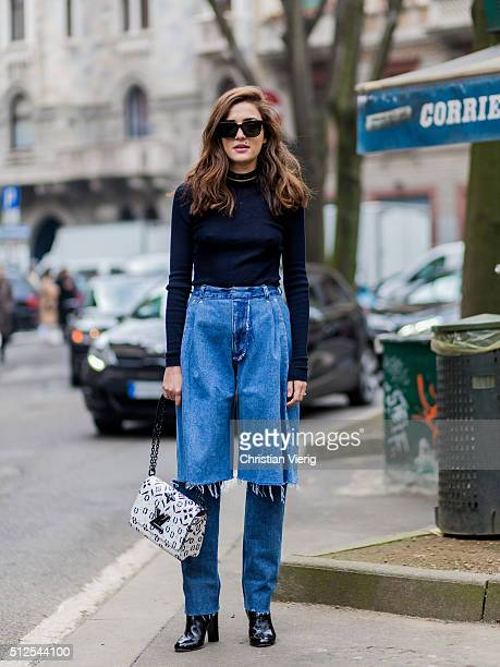 Eleonora Carisi wearing a denim jeans and a white Louis Vuitton bag seen outside Sportmax during Milan Fashion Week Fall/Winter 2016/17 on February...