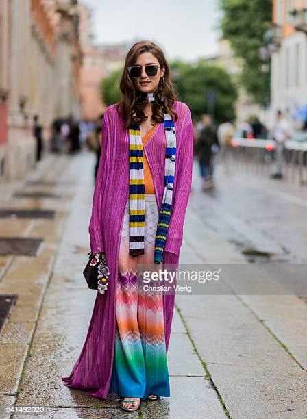 Eleonora Carisi wearing a pink cardigan pink sweater scarf and Missoni pants outside Missoni during the Milan Men's Fashion Week Spring/Summer 2017...