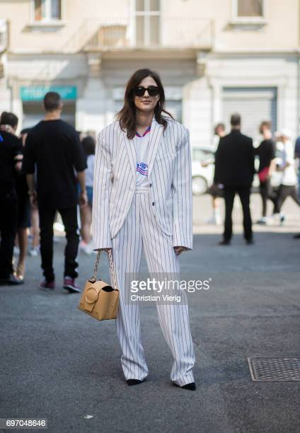 Eleonora Carisi wearing a striped suit is seen outside Diesel during Milan Men's Fashion Week Spring/Summer 2018 on June 17 2017 in Milan Italy