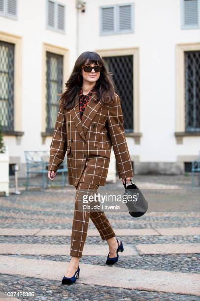 Eleonora Carisi wearing brown checked suit and Tod's black bag is seen before the Tod's show during Milan Fashion Week Spring/Summer 2019 on...