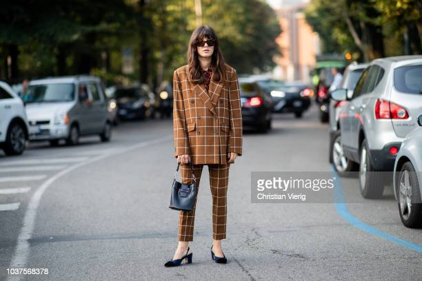 Eleonora Carisi wearing brown checked suit is seen outside Tods during Milan Fashion Week Spring/Summer 2019 on September 21 2018 in Milan Italy