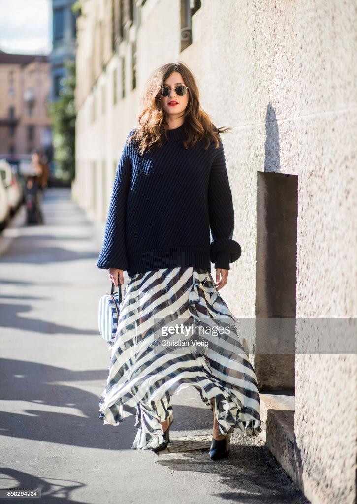 Eleonora Carisi wearing navy knit, striped skirt is seen outside Alberta Ferretti during Milan Fashion Week Spring/Summer 2018 on September 20, 2017 in Milan, Italy.